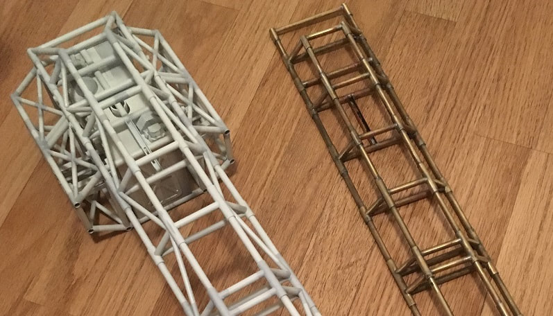 "brass hardware in raw soldered condition and painted for the 44"" studio scale model eagle transporter"